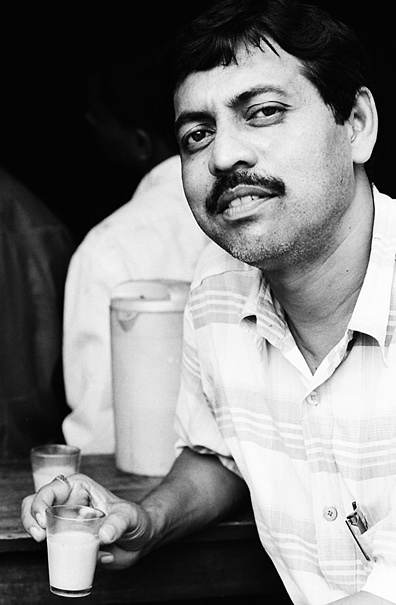 Man drinking a cup of Chai