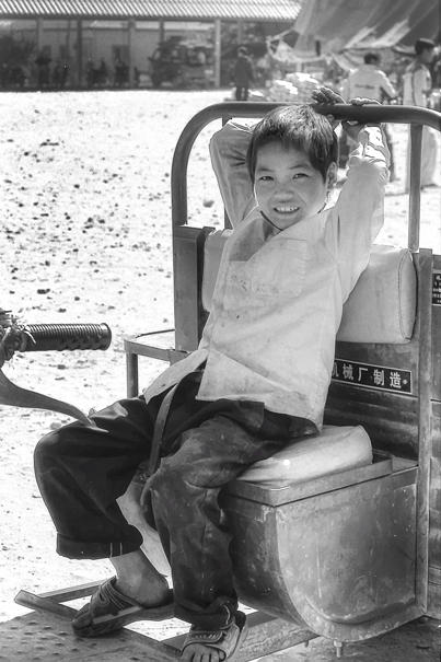 Boy On A Tractor (Laos)