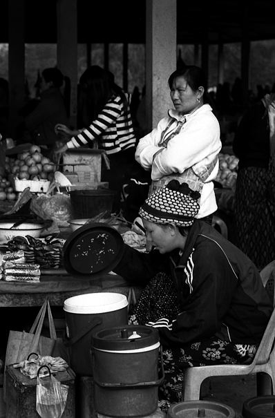 Women Working At The Market (Laos)