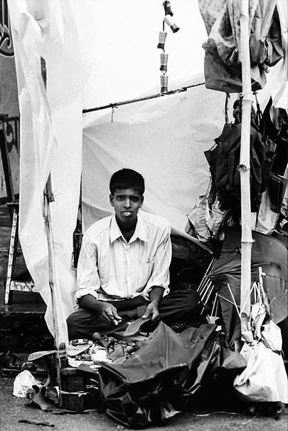 Man And Umbrellas @ India