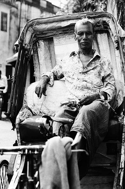 Man Sitting On A Cycle Rickshaw (India)