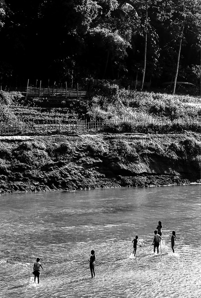 Silhouettes In The Shallow Water (Laos)