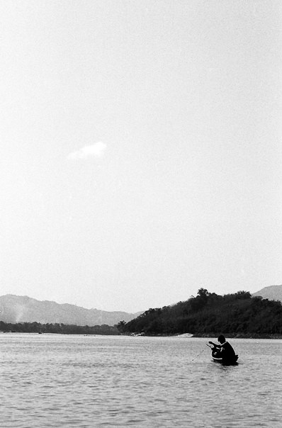 Lonely Fisherman In The Mekong River (Laos)