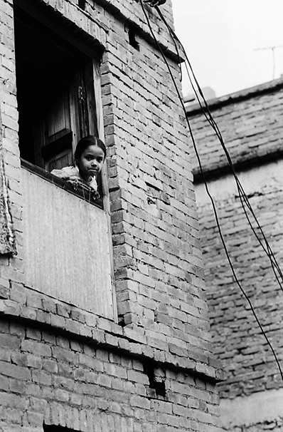 Girl Leaning Out From The Window (Nepal)