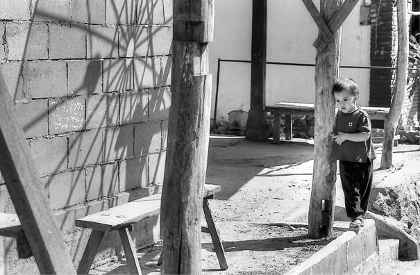Boy And A Wooden Column @ Laos
