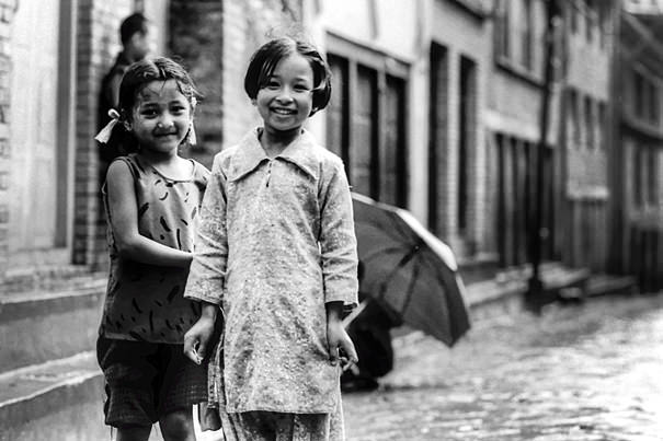 Two Smiles In The Wet Lane (Nepal)