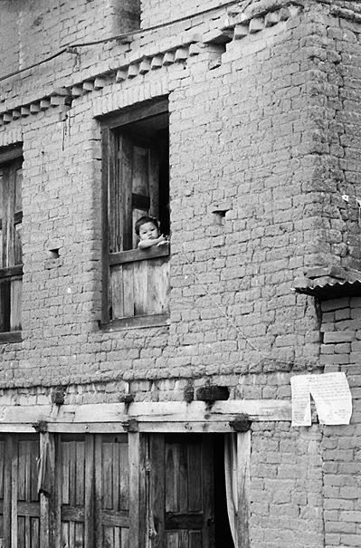 Little Kid By The Window (Nepal)