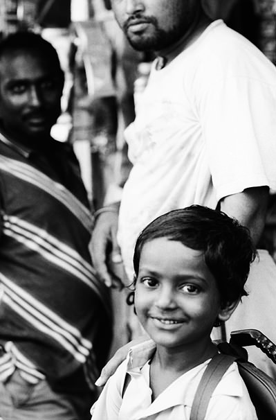 Boy Wearing A Backpack Smiled (India)