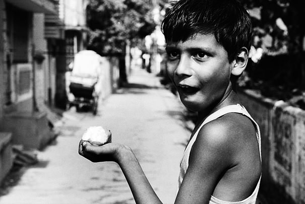 Boy Holding A Mango (India)