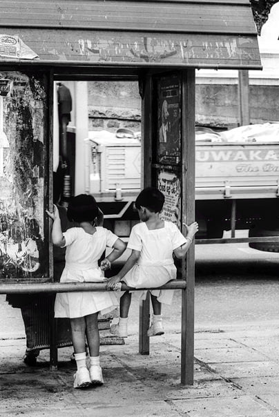 Two Little Girls At A Bus Stop @ Sri Lanka
