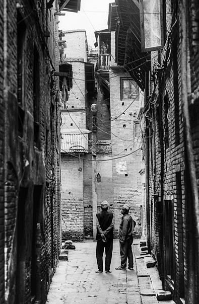 Two Men Between Buildings (Nepal)