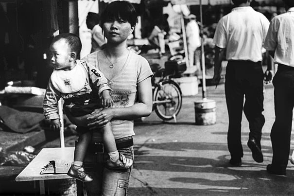 Mother Holding Her Baby @ China