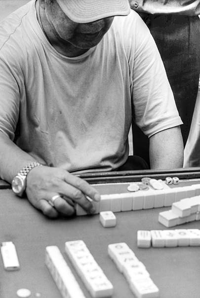 Man Playing Mahjong @ China