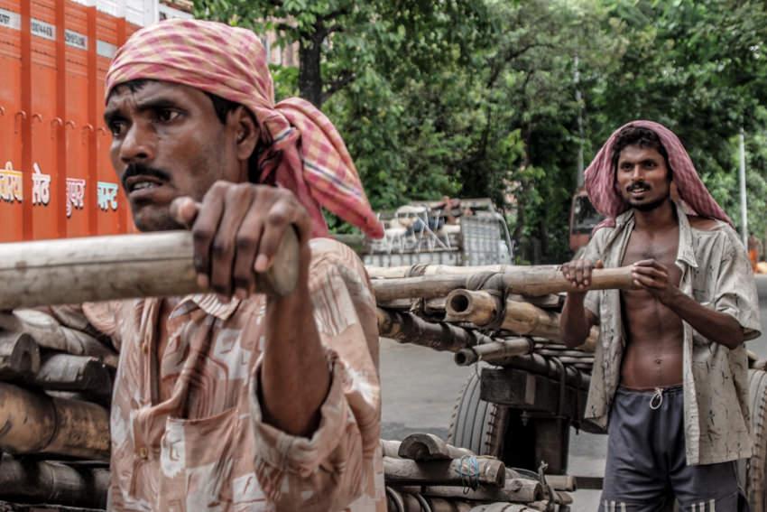 Men pushing cart