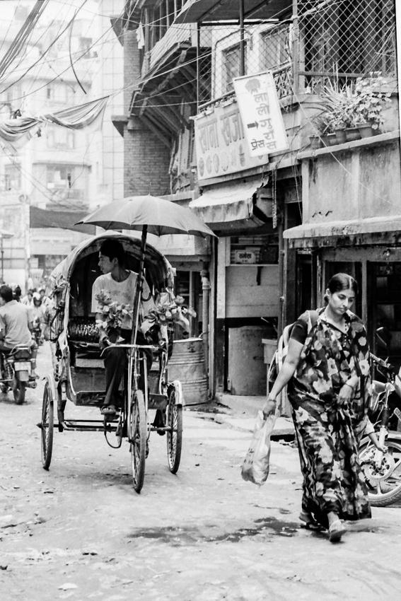 cycle rickshaw and woman