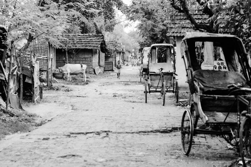 Cycle rickshaws parked in lane