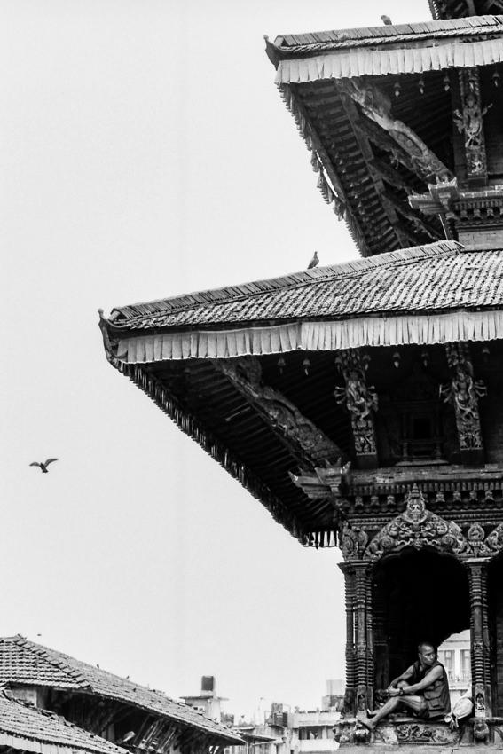Man relaxing in Hindu temple