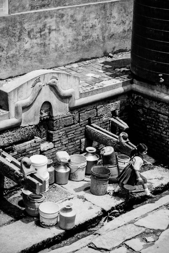 井戸のところにいた女の子