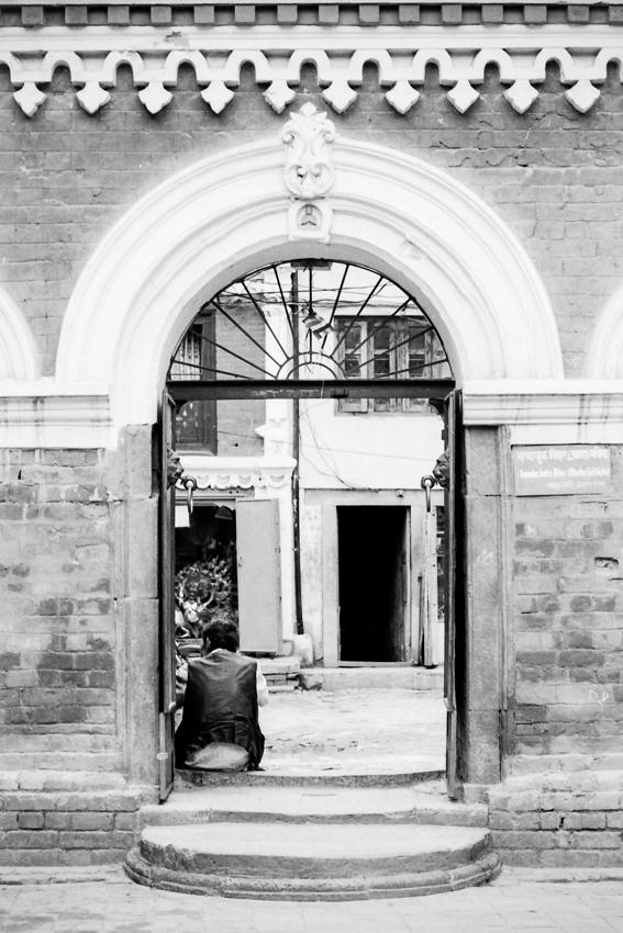 Man sitting at gate
