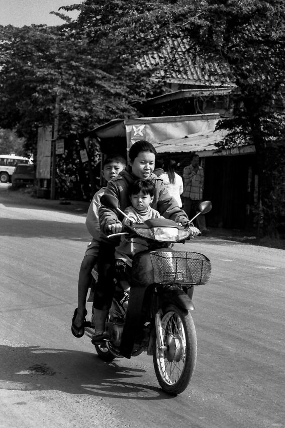 Mother and two sons on motorbike