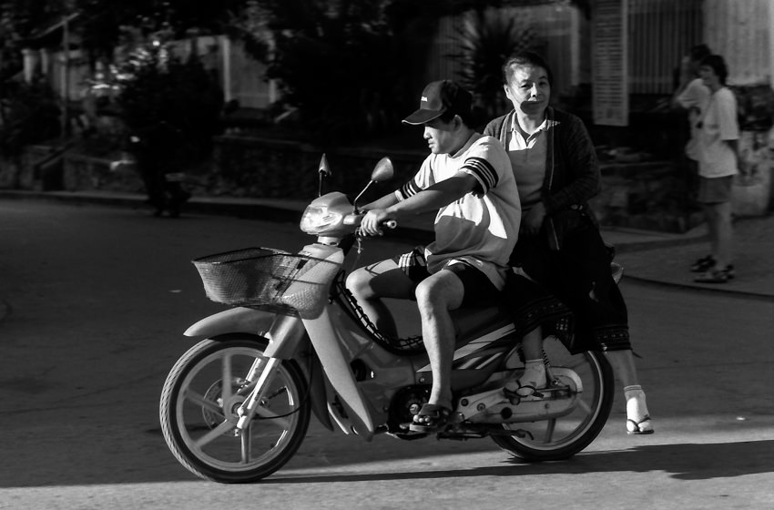 Husband and wife on a motorbike