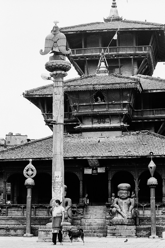 Woman in front of Hindu temple