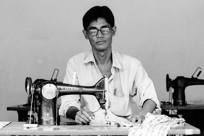 Seamster with glasses