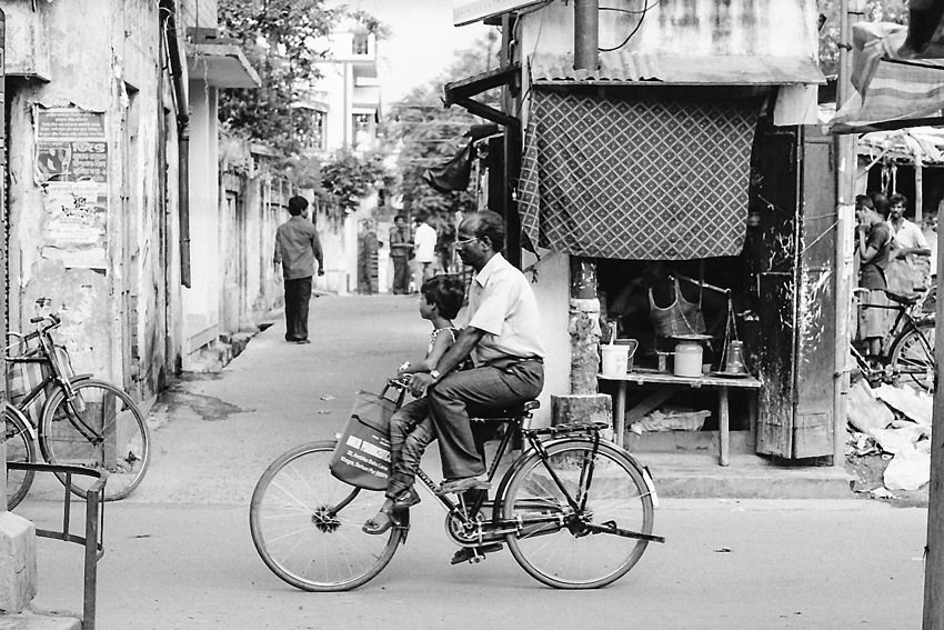 Daughter and father on bicycle