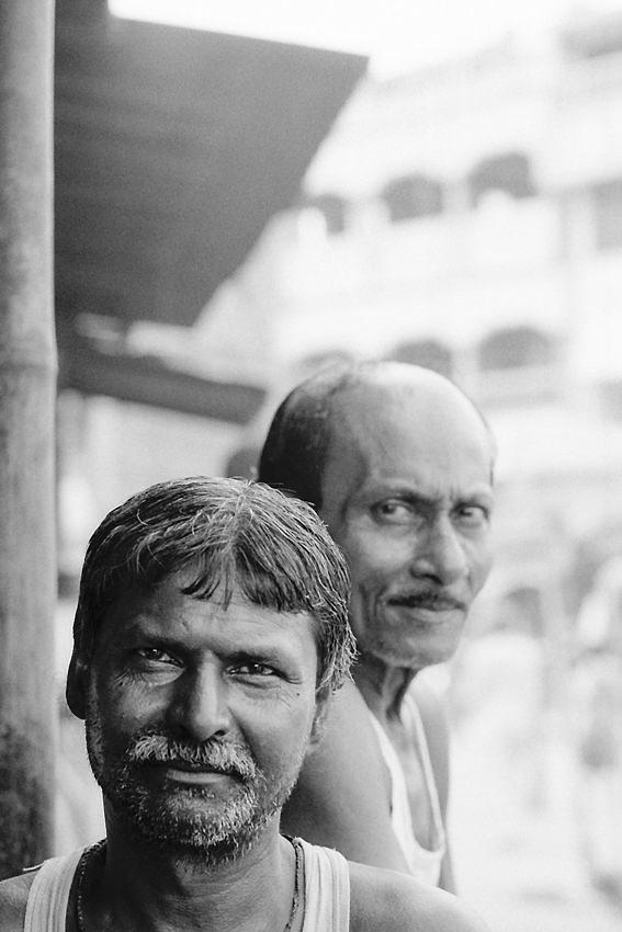 Men in chai stand