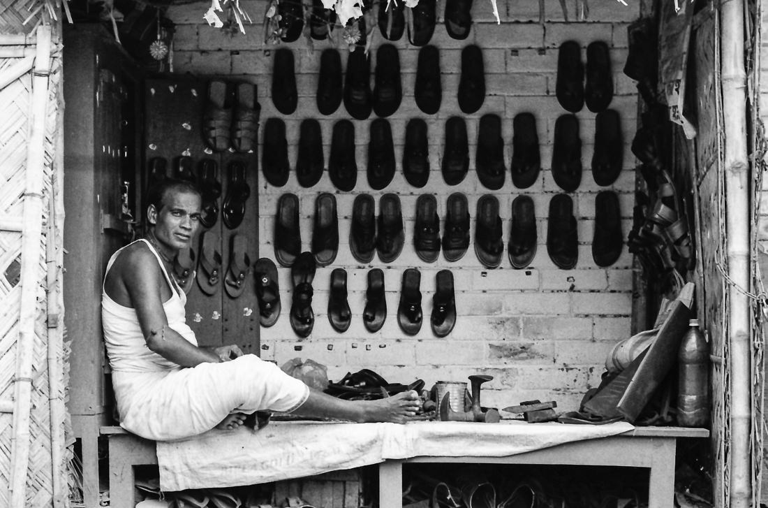 Man selling sandals