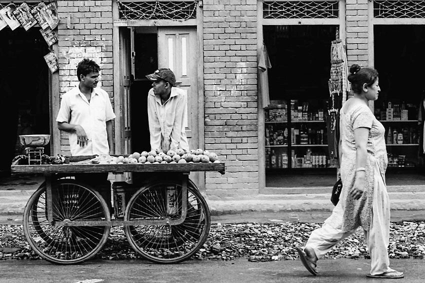 Men standing beside wagon