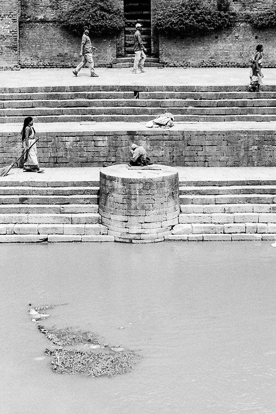 People walking on riverbank