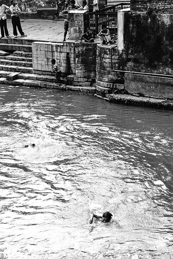 Boy swimming in holy river