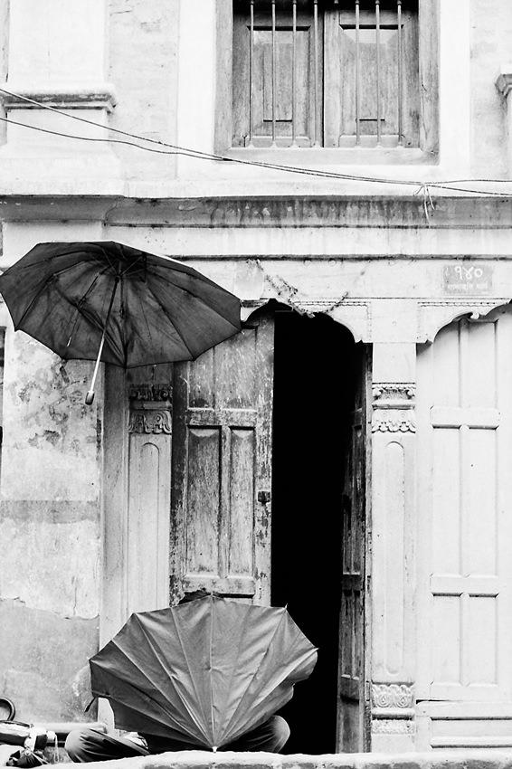 Umbrella repairman working