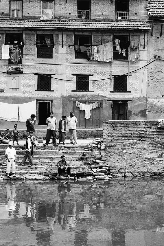 Men watching water surface