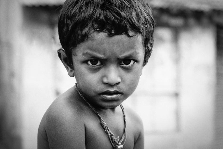 Boy with arch of eyebrow