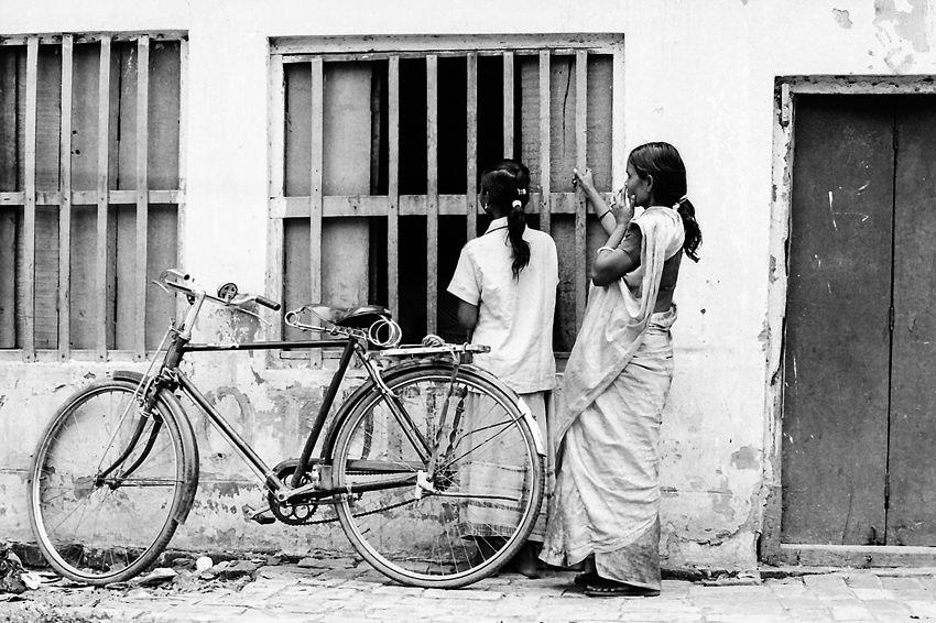 Women standing in front of window