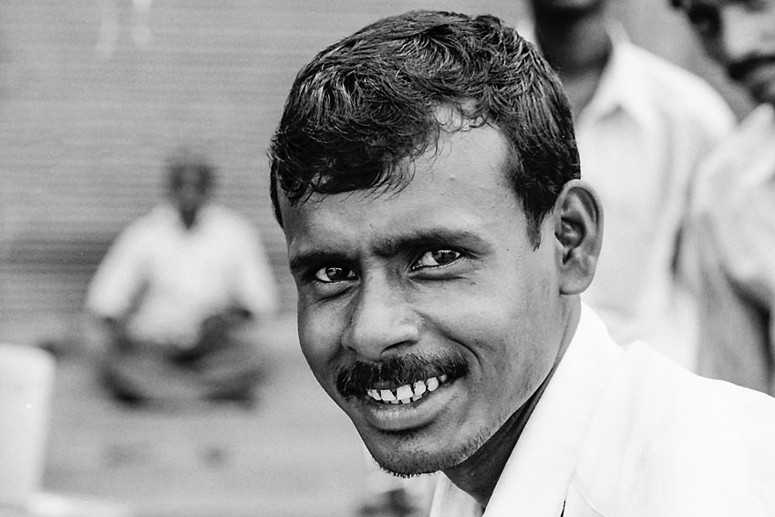 Man looking at camera curiously