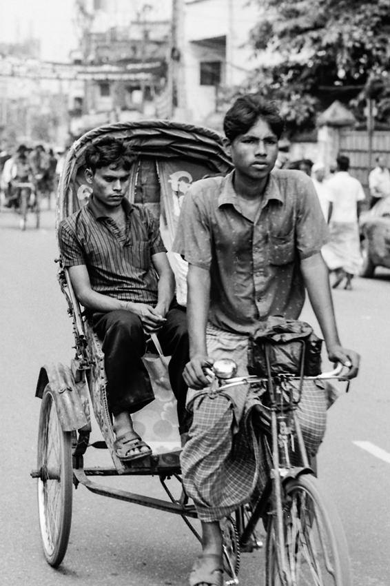 Rickshaw wallah pedaling cycle rickshaw