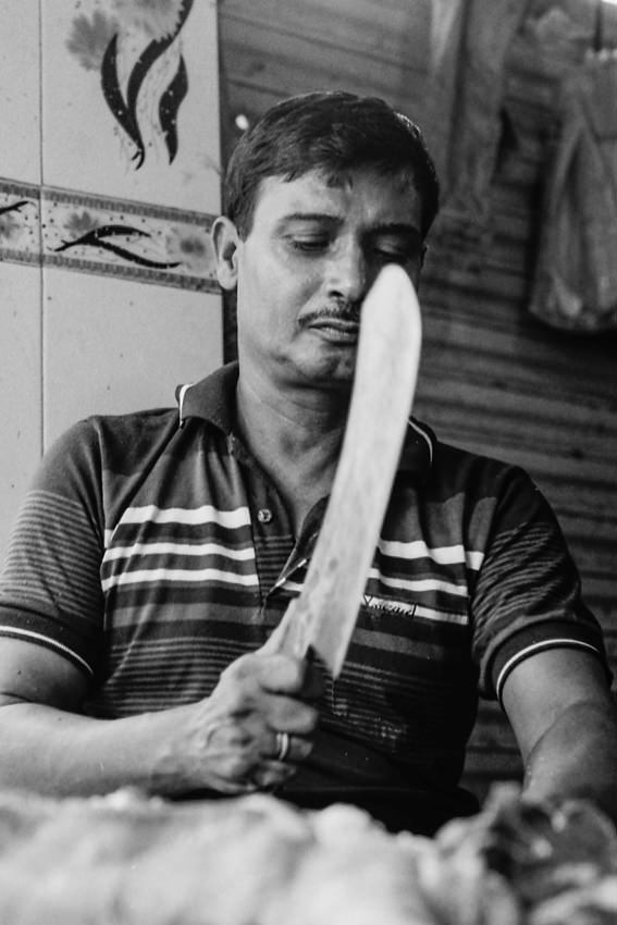 Butcher holding big knife