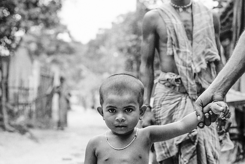 Boy taken by hand