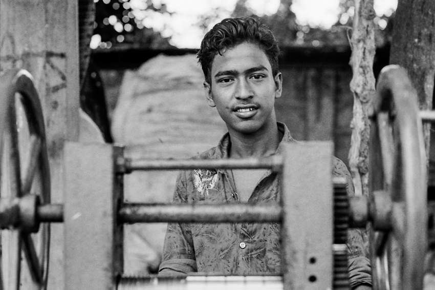 Young man selling sugar cane juice