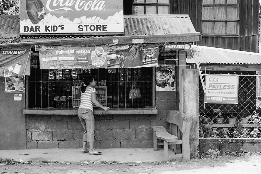 Woman standing at general store