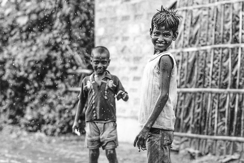 Boys playing in rain