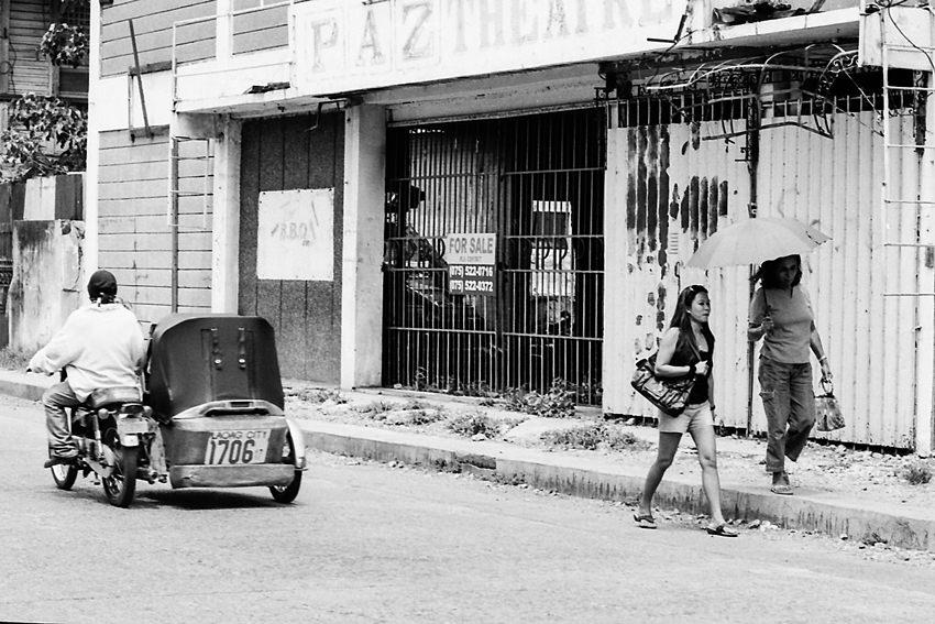 Two women walking sidewalk