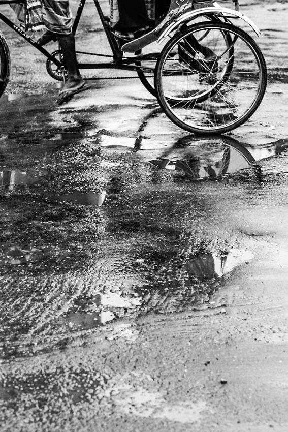 Cycle rickshaw on wet ground