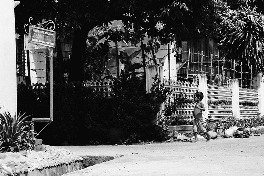 Little boy walking alone