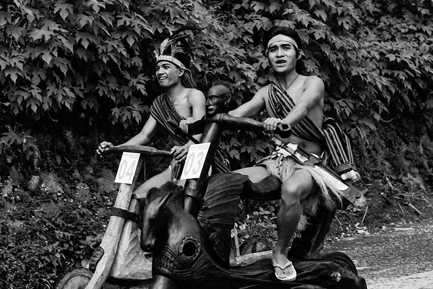 Men on wooden bikes