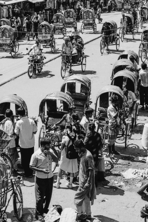 People getting on cycle rickshaw