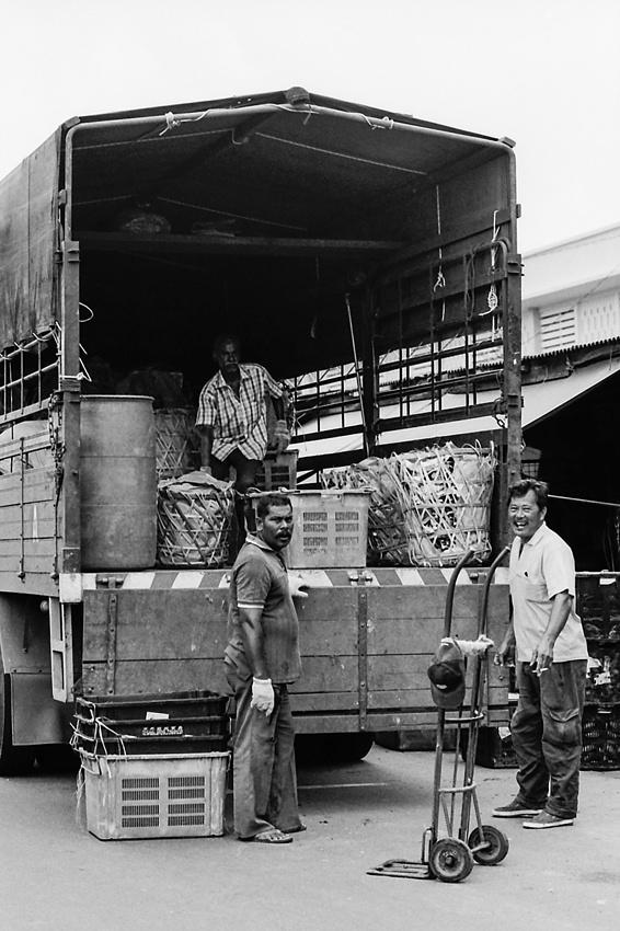 Men delivering goods in market